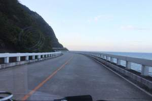Patapat Viaduct where adults can get off the car for a pic. Not encouraging kids to pose for a pic as the long and zigzag road is actually a highway and 4th longest bridge in the Philippines, overlooking Pasaleng Bay.